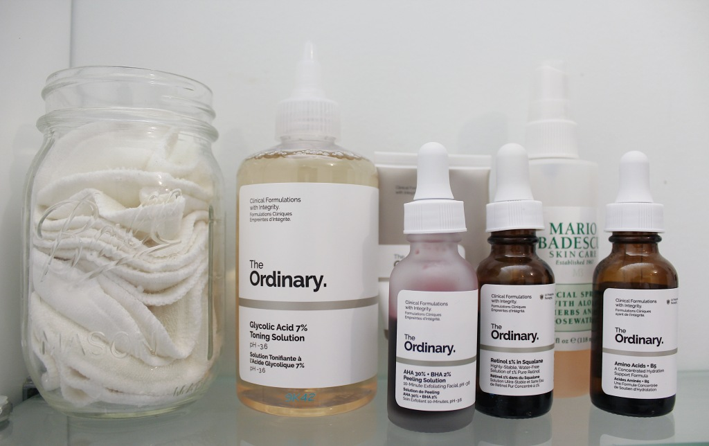 shelfie of The Ordinary brand serums and reusable cotton pads